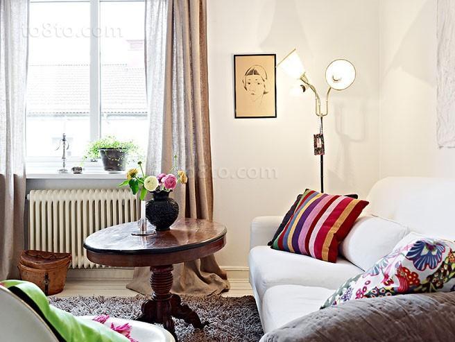 70平单身公寓客厅沙发装修效果图大全2014图片