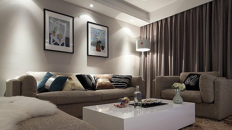 现代风格二居客厅沙发照片墙装修效果图